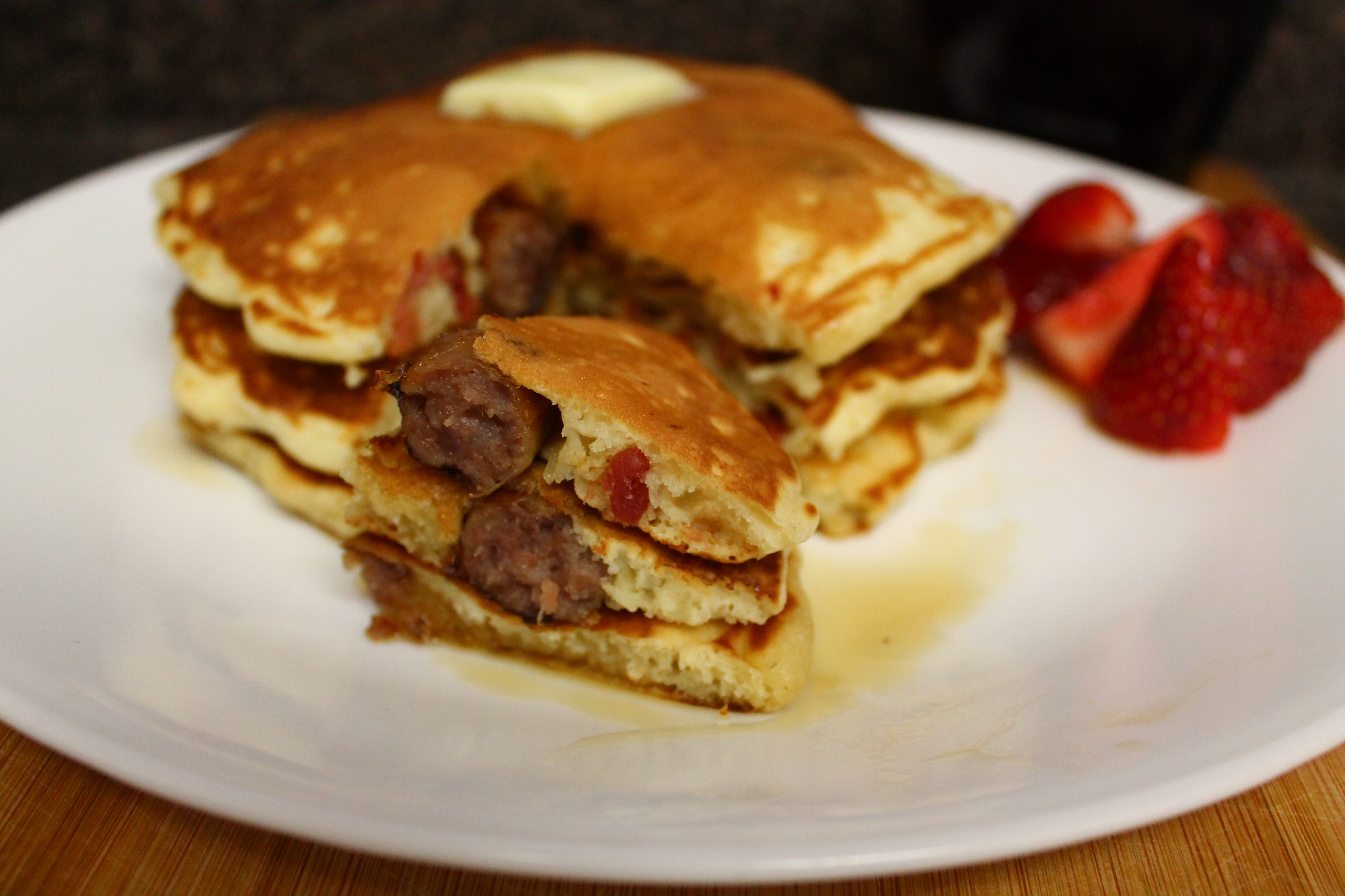 Bacon and Sausage Stuffed Pancakes Man in Kitchen